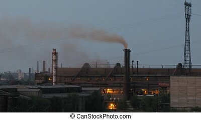 Smoke ceases going from factory pipe at evening, time lapse