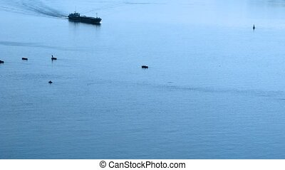 Two steamers pass near fishing boats on Volga River, time...