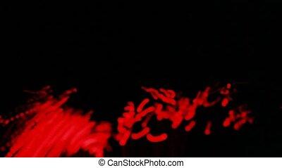 Closeup of beam light lines shine on black