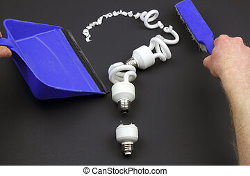 Recycle CFL Bulbs - Three cracked spiral compact fluorescent...
