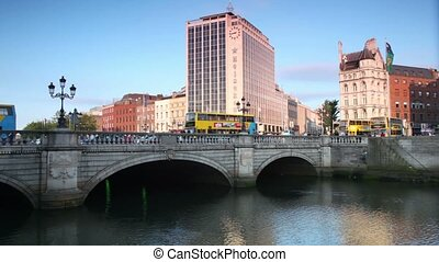 Cars and passer-by on O'Connell bridge on Liffey bridge