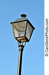 Streetlamp, on blue sky background