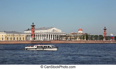 Boat floats on river at Basil Island in St. Petersburg -...