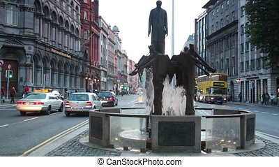 people and cars near Thomas Davis Fountain - DUBLIN - JUNE...
