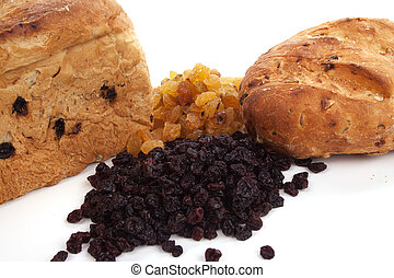Currant-bread with raisins and currants against white
