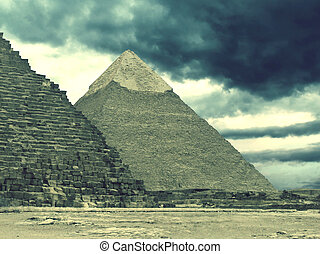 Pyramids of Gizeh near Cairo in Egypt on a cloudy evening