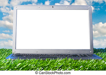 laptop outdoors - modern laptop with blank screen on grass...