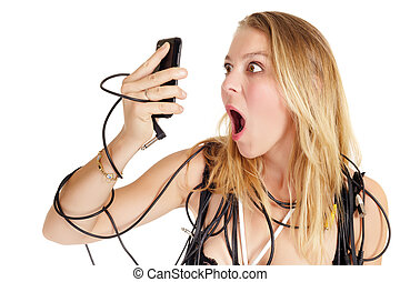 shocked woman phoning - shocked blond woman looking on...