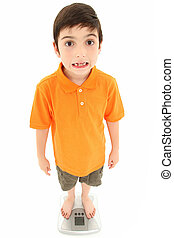 Attractive Boy Standing on Scale - Attractive 8 year old boy...