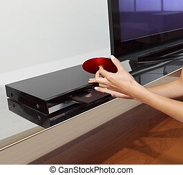 dvd player - Inserting a disc into a DVD or CD player