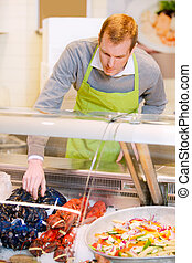 Seafood Fresh Food - A fresh fish counter and a grocery...