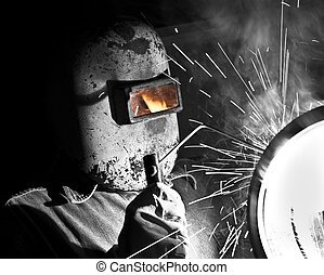 Stick welding - A craftsman stick welding on pipe