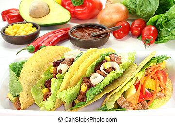Taco shells filled with ground beef, kidney beans and corn