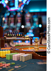 roulette wheel table with chips piles - still life shot at a...