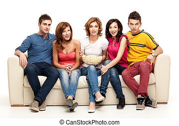 television gathering - friends sitting on couch watching tv
