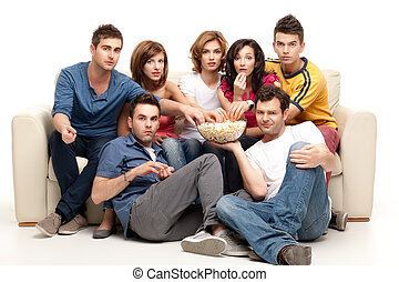 friends sitting comfortable with popcorn - friends sitting...