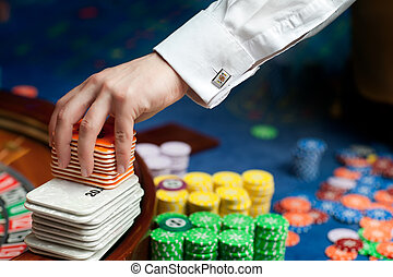 hand of a poker dealer - hand of professional casino dealer...