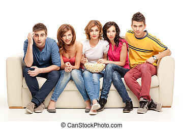 young group of friends watching questioning movie - amazed...