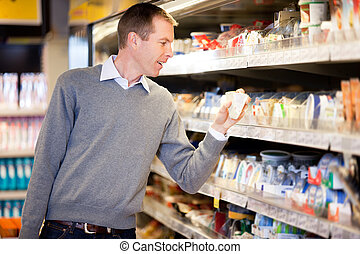 Grocery Store Man - A man buying cheese and comparing prices...