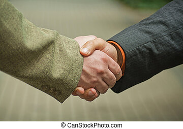 Shaking hands - Closeup picture of businesspeople shaking...