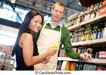 Grocery Store Help - An asian woman in a grocery store...