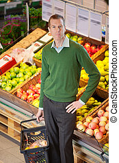 Portrait of serious man in shopping centre - Serious man...