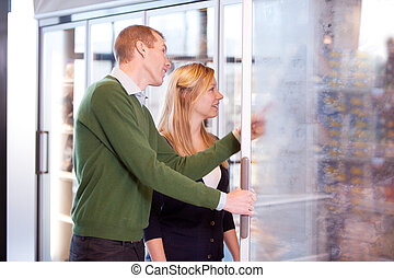 Couple in Frozen Food Section - A happy couple buying...