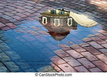 reflection in the puddle - reflection building in the puddle...
