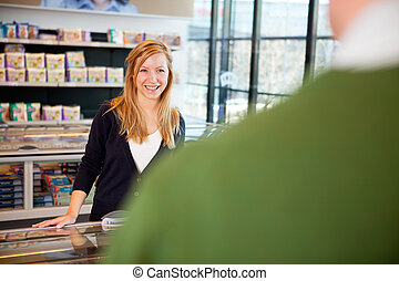 Supermarket Woman Flirt - a woman smiling and flirting with...