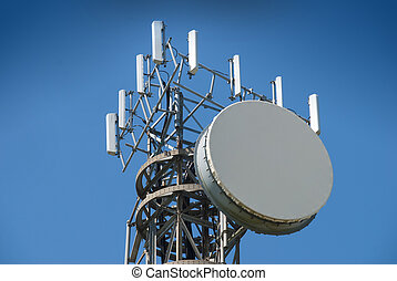 Cellular antenna tower against blue sky