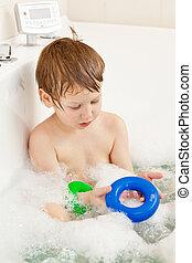 Boy taking bath - Happy little boy taking bath at home