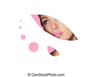 beautyfull blonde woman looking thrue paper cut