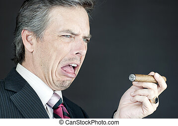 Businessman Looks At Cigar In Disgust - Close-up of a...