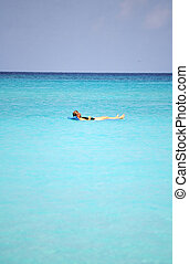 Cruise vacation. - Female relaxing in the ocean on a cruise...