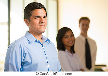Hispanic Male Team Leader Row - A singled out handsome...