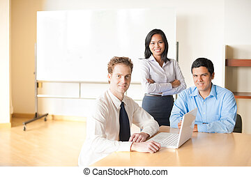Team Meeting Conference Room Table - A caucasian businessman...