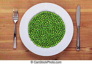 Peas on a white plate