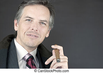 Successful Businessman Holds Cigar - Close-up of a...