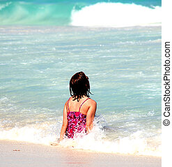Beach summer vacation. - Female enjoying the water on her...