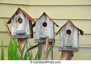Three birdhouses - Three wooden birdhouses in the garden