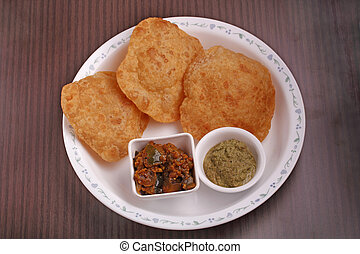 Poori with chutney and subzi - Indian deep-fried bread -...