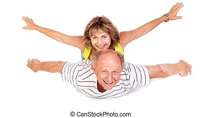 Senior couple having fun, indoors Isolated against white