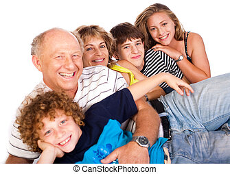Happy family having fun together lying in studio, posing