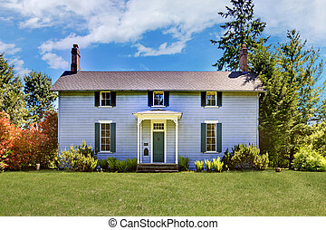 Grey classic historical home from 1856 in Washington State....
