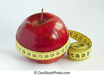 Yellow tape Measure with red Apple