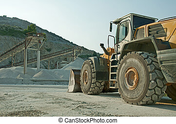 Quarry and Bulldozer Vertical image
