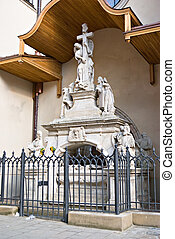 statuary angel with a cross under a canopy