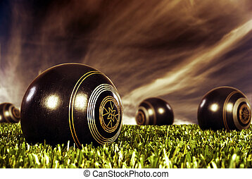 Close up of bowling balls on a bowling field at sunset