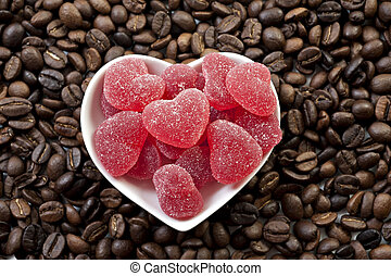 Red heart shaped jelly sweets and coffee beans