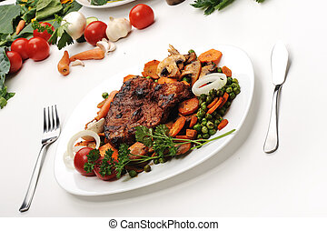 Meat with Vegetables and Greens - prepared and served meal